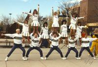 Cheer squad perform stunts near the Centennial Student Union at Mankato State University, 1989-10-20.