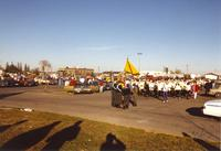 Mankato State University student and staff prepare for the parade in a parking lot at Mankato State University, 1989-10-20.