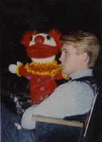 Gregg Peterson holding a puppet at Mankato State University May 1, 1990.