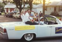 Senator mark Piepho and his family at the parade near Mankato State University, 1990-07-07.