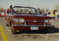 A red Chevrolet Corviar at the parade at Mankato State University, 1989-10-20.