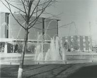A picture of the Mankato State University fountain, Memorial Library, campus mall and the Nelson Hall academic building, 1980s.