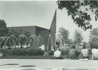Mankato State University students sitting by the fountain studying, 1980s.