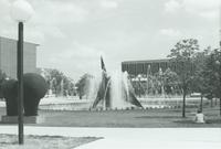 A picture of a Mankato State University student sitting by the university fountain, 1980s.