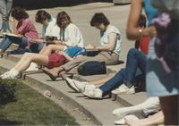 Students sitting on some steps reading at Mankato State University