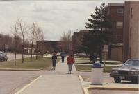 Walking outside of McElroy Hall, at Mankato State University.