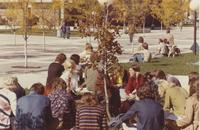 Students and a professor having class outside of Armstrong Hall at Mankato State College