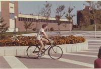 Student riding his bike at Mankato State University