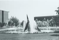 A the picture of Mankato State University fountain, Memorial Library, and the Nelson and Armstrong Hall academic buildings, 1980s.