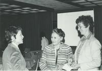 Mankato State Teachers College alumni Faith Sullivan, talking to two other women at Mankato State University.