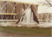 A picture of the Mankato State University fountain, Campus Mall, Memorial Library and Nelson Hall academic building, 1980s.