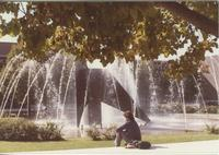 A Mankato State University student sitting the fountain, 1980s.