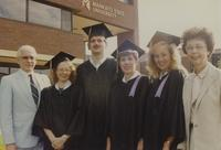 Four Mankato State University graduates taking a photograph with unidentified man and woman, 06-07-1991.
