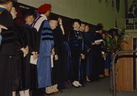 Group of Mankato State University faculty members and administration on the stage at commencement. 06-07-1991.