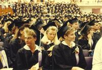 Mankato State University graduates sitting during commencement ceremony.