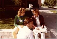 Students sitting down outside near the Centennial Student Union at Mankato State University