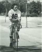 A student riding his bike at Mankato State University