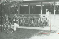 Two Female students by a bike rack at Mankato State University
