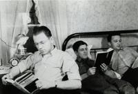 Three male students reading at Mankato State Teachers College. (1938)