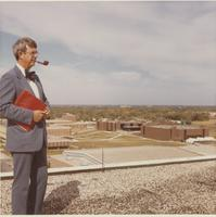 Dr. Douglas Moore, President of Mankato State College, on top of Gage Center tower.