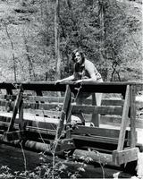 Mankato State University President Margaret Preska posing on a wooden bridge.