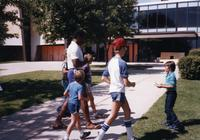 Evan Rusch and fans asks for MN Vikings Player Matt Blair's autograph at Mankato State University, August 1983.
