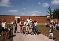 MN Vikings Player Bob Bruer is surrounded by fans at Mankato State University, August 1983.
