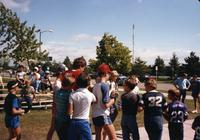 Fans surround MN Vikings Player Tommy Kramer at Mankato State University, August 1983.