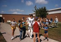 Fans with MN Vikings Player Joe Senser at Mankato State University, August 1983.