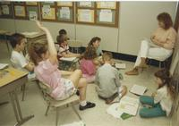 A student teacher with young students in a classroom, Mankato State University.