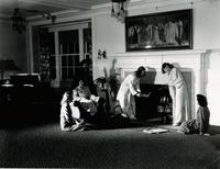 Six female students enjoying a night in Daniel Buck Hall at Mankato State Teachers College. Between 1948-1952
