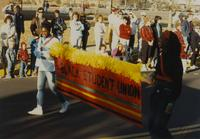 Black Student Union members at Homecoming Parade near Mankato State University, 1989-10-20.
