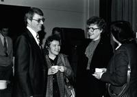 Four people socializing at Mankato State University, 1980. (Left to Right) Allan R. Pardoen (Associate Dean of Extended Campus and Continuing Education), unknown woman, Margaret Preska (President Mankato State University) and unknown woman.