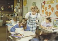 A student teacher assisting students in the classroom, Mankato State University.