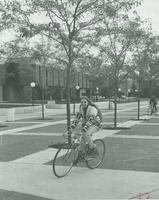 Student riding her bike, Campus Mall at Mankato State University