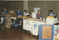 A picture of organization members sitting at their booths during a Minnesota Valley Association for the Education of Young Children conference in the Mankato State University Centennial Student Union, 1991.