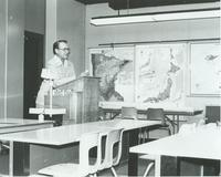 Dr. Arthur M. Grove, Professor of Geography standing in front of a classroom at Mankato State University