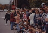 Residents and students gathers for the Homecoming Parade near Mankato State University, 1994.