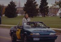 Student riding in the Homecoming Parade near Mankato State University, 1994.
