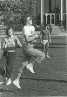 A group of Mankato State University students playing football outside of the Performing Arts Center, 1980.