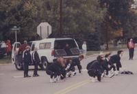 Students dance at the Homecoming Parade at Mankato State University, 1994.