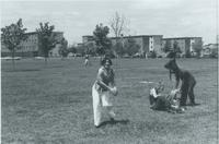 Students on front lawn of Performing Arts Center, Mankato State University.