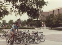 Male student at the Campus Mall bike rack, Mankato State University