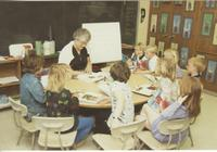 A teacher reading to a small group of students, Mankato State University.