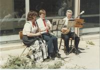Pauline Kracak, Ron, Lowell Schreyer playing instruments at the Advancement Spring Potluck, Mankato State University.