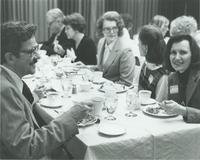 A group of people eating in the eating Mankato State University Centennial Student Union Ballroom during a Public Affairs Institute meeting, 1979.