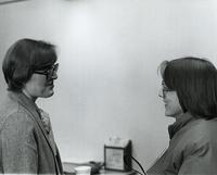 President Margaret Preska talking with Marilee Rickard at Mankato State University, 1980.