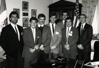 Minnesota State University Student Association posing for a photo inside an office with Tim Penny