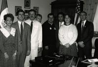 Minnesota State University Student Association posing for a photo inside an office with Tim Penny, far right.