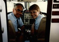 Michelle Strenge and another gentlemen in the cockpit of a turbo-prop aircraft.  Taken on a trip for the Aviation Management Program, Mankato State University.